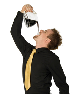 Business man drunking a whole pot of coffe by pouring it straight down his throat